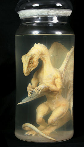 HAND OUT PHOTOGRAPH SHOWS A FAKE BABY DRAGON IN JAR FOUND IN OXFORDSHIRE GARAGE